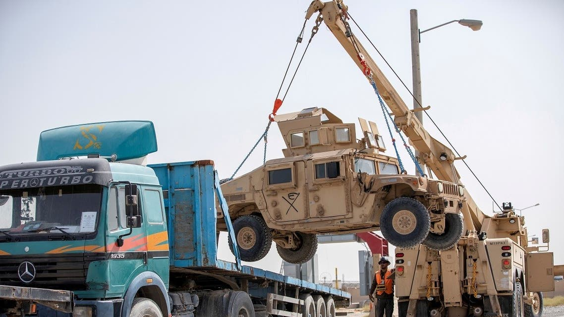 US Army soldiers and contractors load HUMVs to be sent for transport as US forces prepare for withdrawal, in Kandahar. (File Photo: Reuters)
