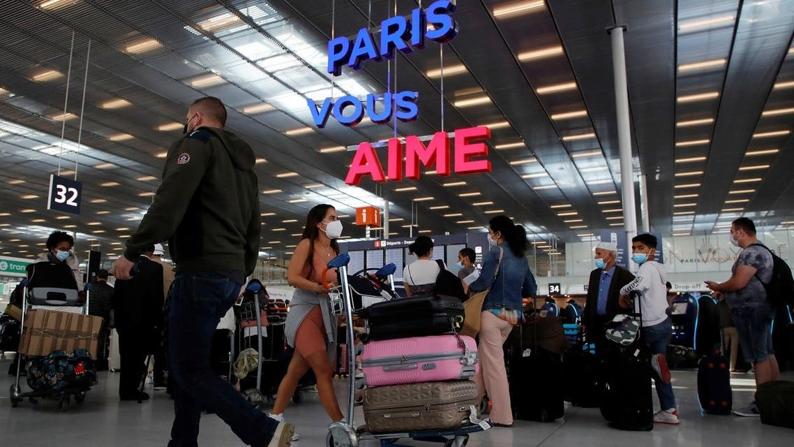 Passengers line up to check in inside the Terminal 3 at Orly Airport, near Paris, France, on July 1, 2021. (Reuters)