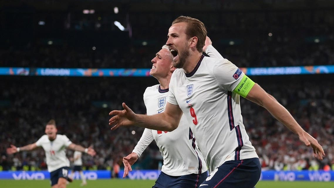England's Harry Kane celebrates scoring their second goal with Phil Foden. (Reuters)