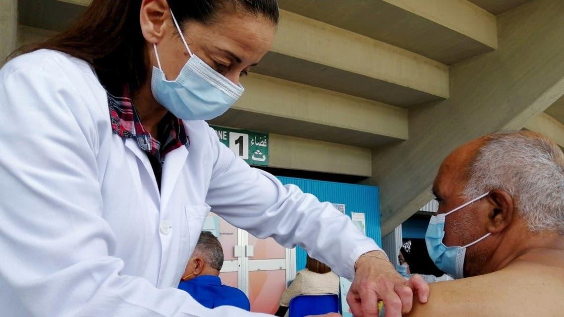 A man receives a coronavirus vaccine at a vaccination centre in Tunis, Tunisia. (Reuters)
