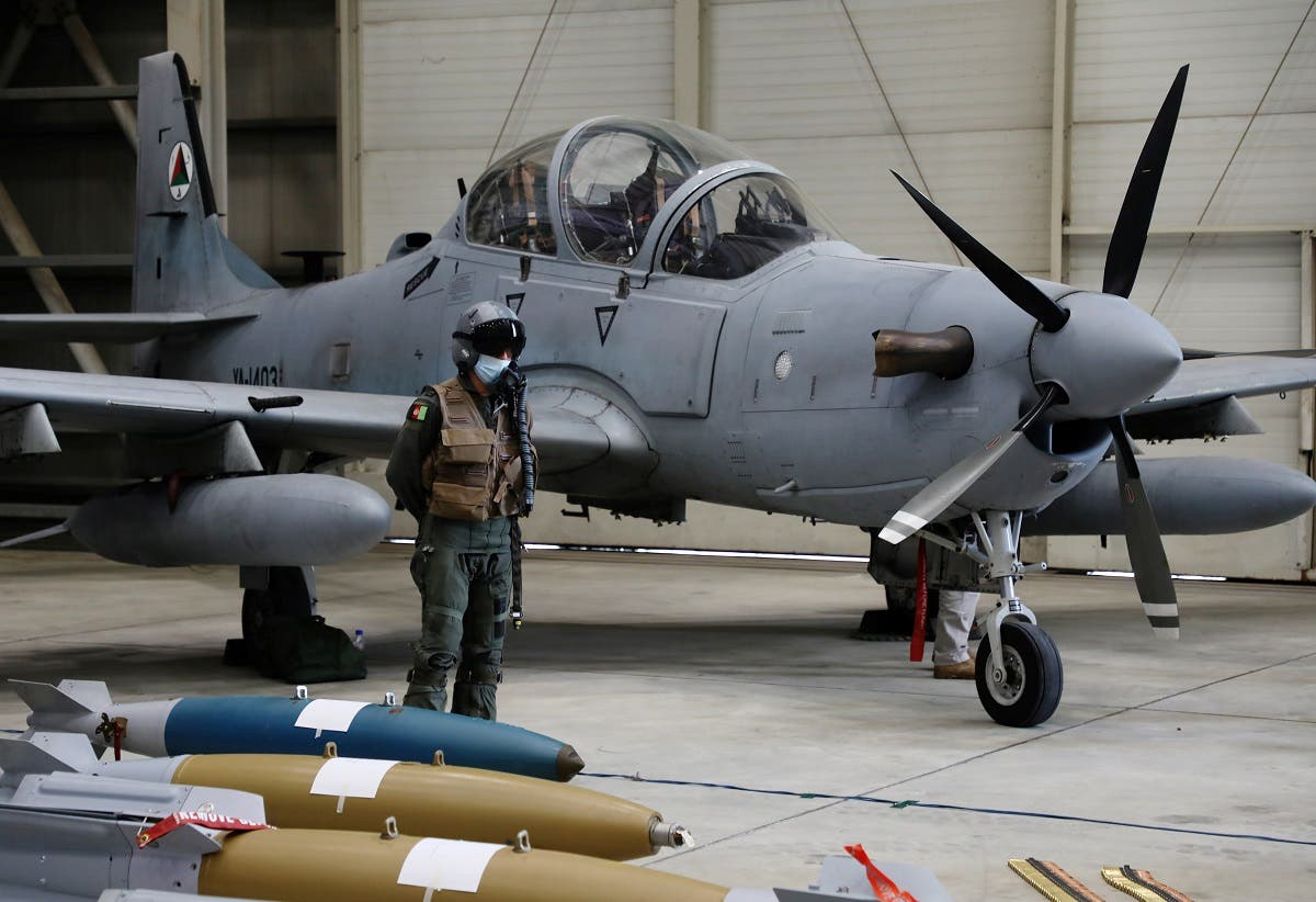 An Afghan pilot stands next to A-29 Super Tucano plane during a handover ceremony of A-29 Super Tucano planes from US to the Afghan forces, in Kabul, Afghanistan, on September 17, 2020. (Reuters)