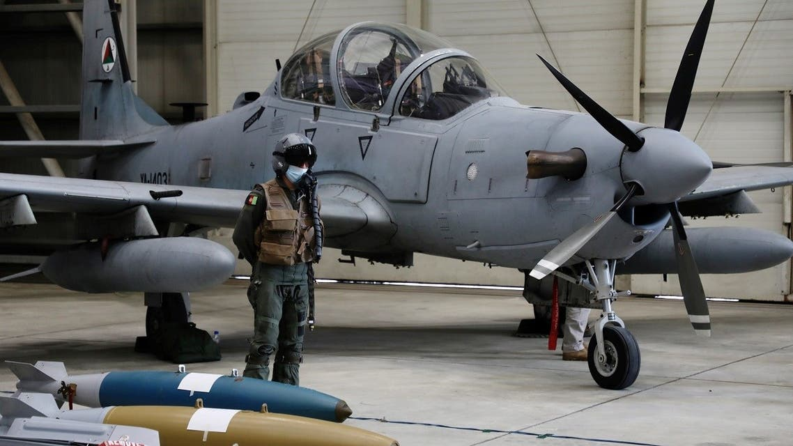 An Afghan pilot stands next to A-29 Super Tucano plane during a handover ceremony of A-29 Super Tucano planes from U.S. to the Afghan forces, in Kabul, Afghanistan, on September 17, 2020. (Reuters)