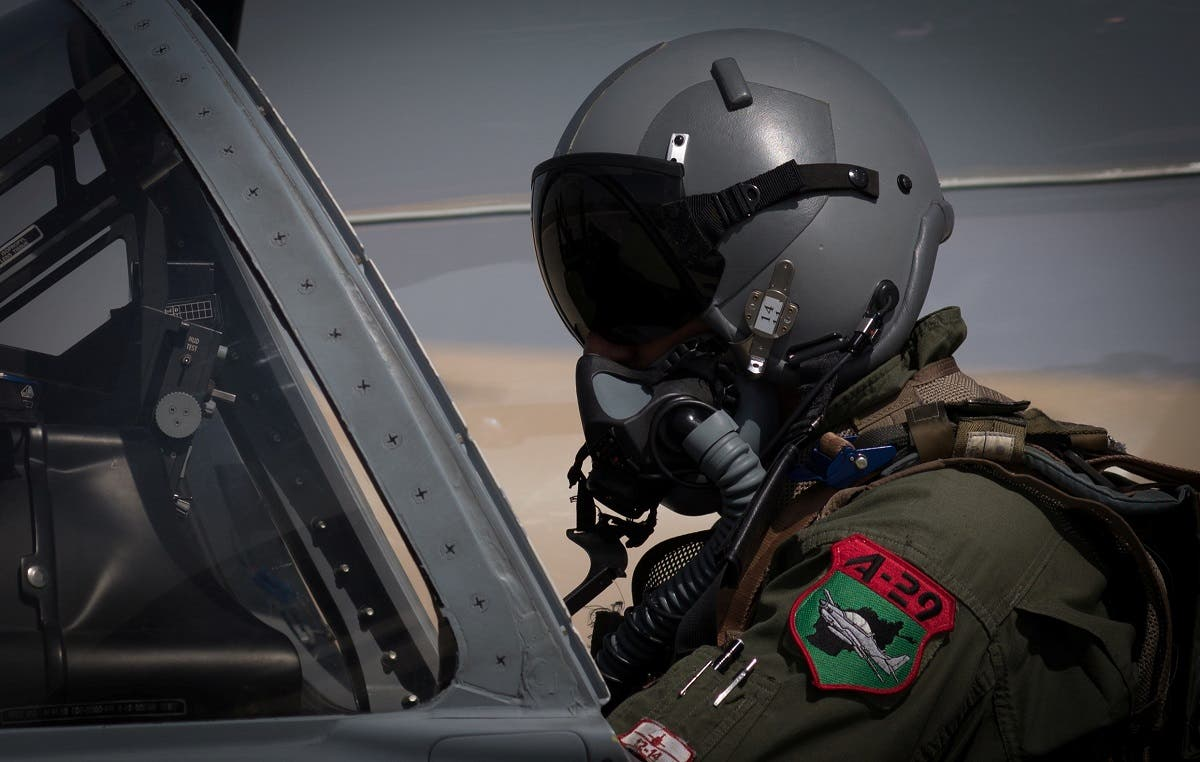 An Afghan A-29 pilot prepared for flight in the cockpit of his aircraft, at Kandahar Airfield, Afghanistan. (Reuters)