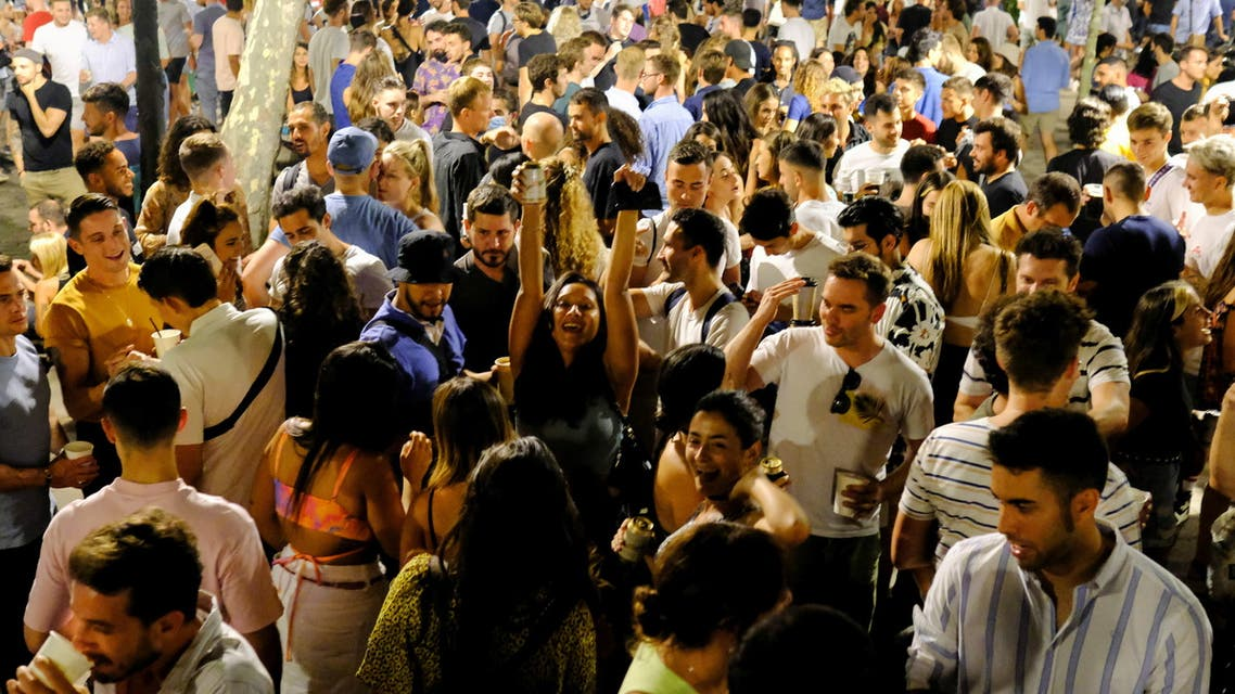 Tourists and locals gather on a street in the Born neighborhood, as indoor nightlife venues were shut again by Catalonia's regional government in a bid to stop the increase of COVID-19 cases in Barcelona, Spain, July 10, 2021. REUTERS/Nacho Doce