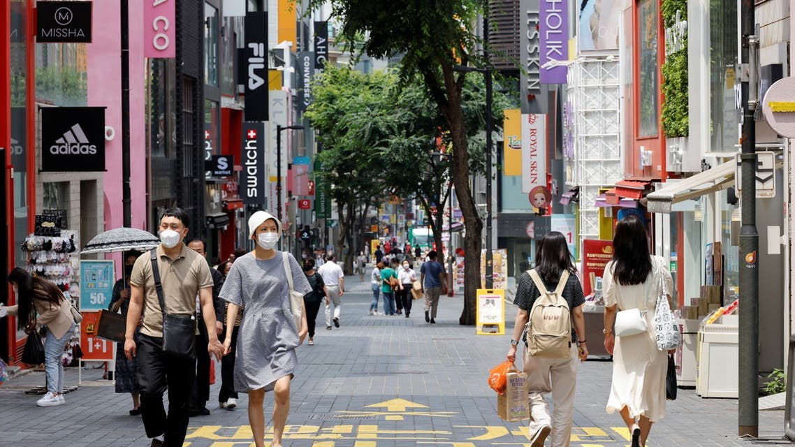 People wearing masks walk in a shopping district amid the coronavirus disease (COVID-19) pandemic in Seoul, South Korea, July 9, 2021. (Reuters)