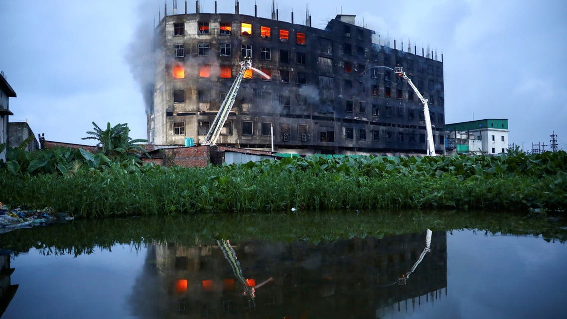 Flames rise the morning after a fire broke out at a factory named Hashem Foods Ltd. in Rupganj of Narayanganj district, on the outskirts of Dhaka, Bangladesh, July 9, 2021. (Reuters)