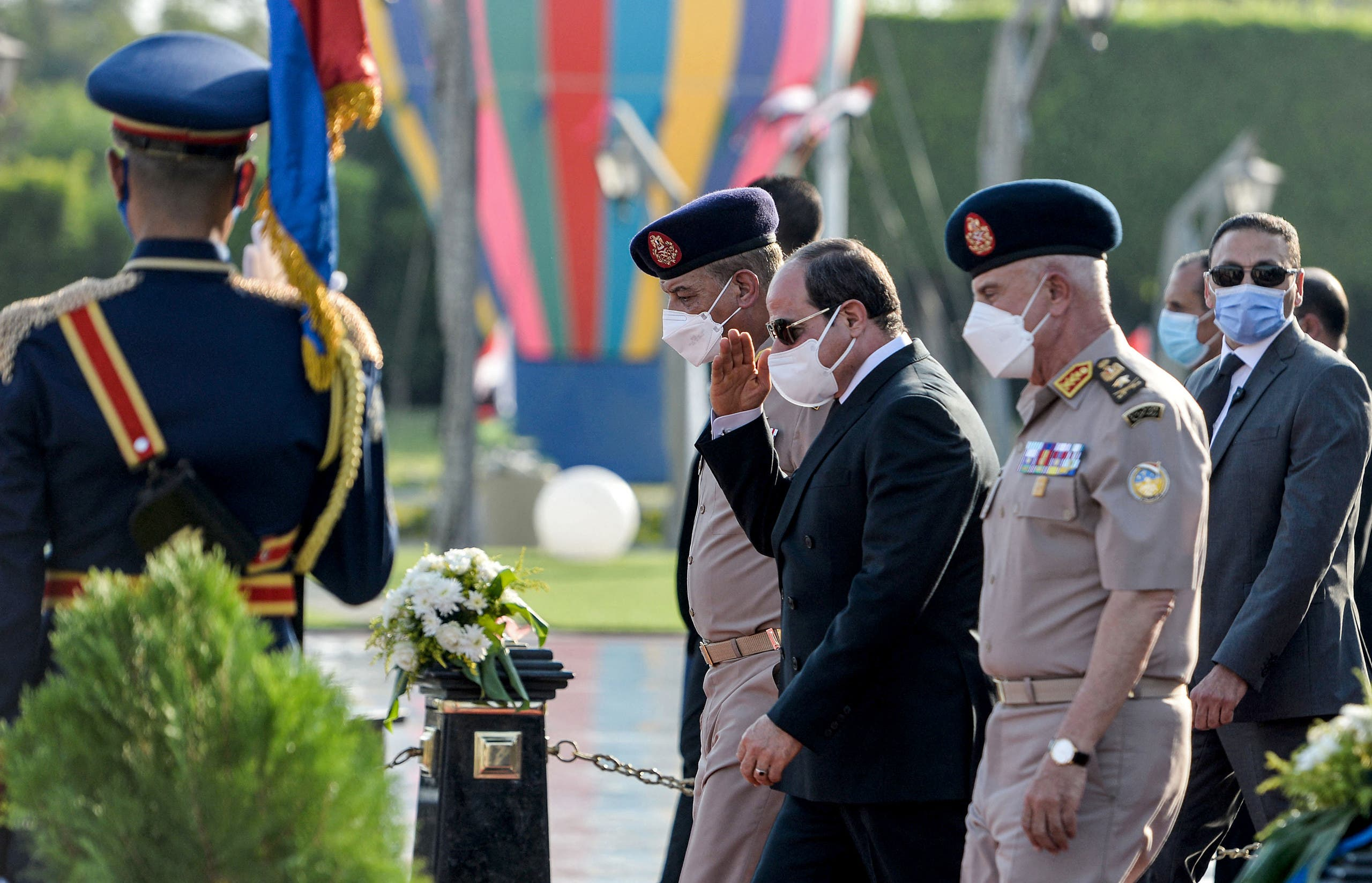 Egyptian President Abdel Fatah al-Sissi (C) attends the funeral of the widow of late president Anwar al-Sadat, Jihan al-Sadat, as she buried next to her husband at the unknown soldier memorial, in Cairo on July 9, 2021. (AFP)
