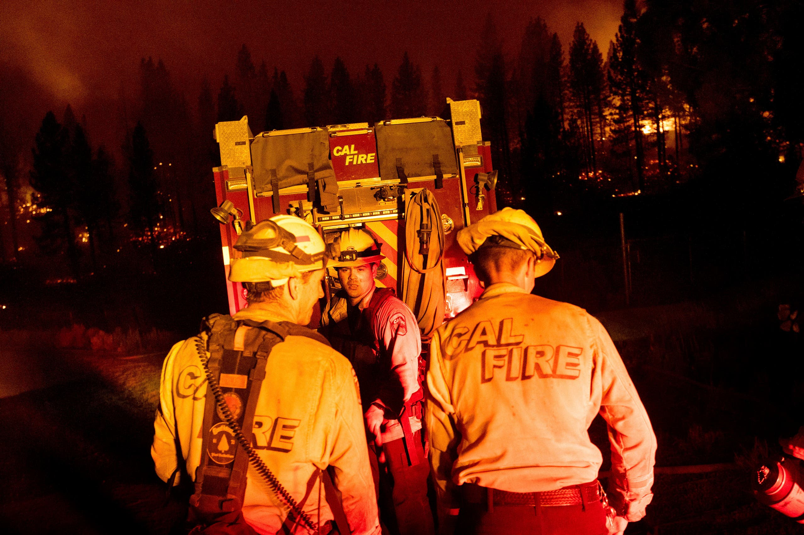 Firefighters work to stop the Sugar Fire, part of the Beckwourth Complex Fire, from spreading near Frenchman Lake in Plumas National Forest, California, on Thursday, July 8, 2021. (AP)