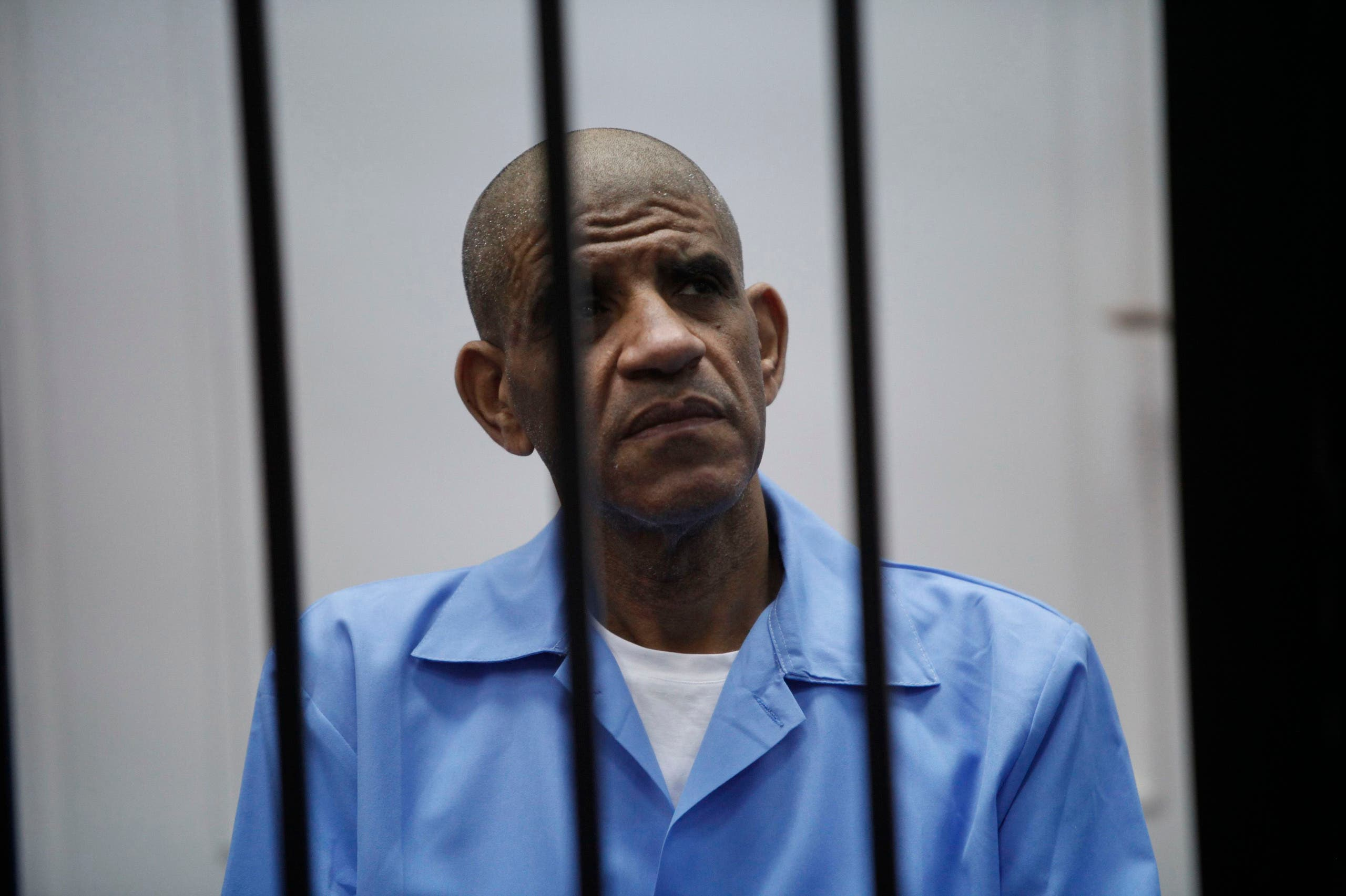 عبدالله السنوسي أثناء محاكمته في 2014 (رويترز)