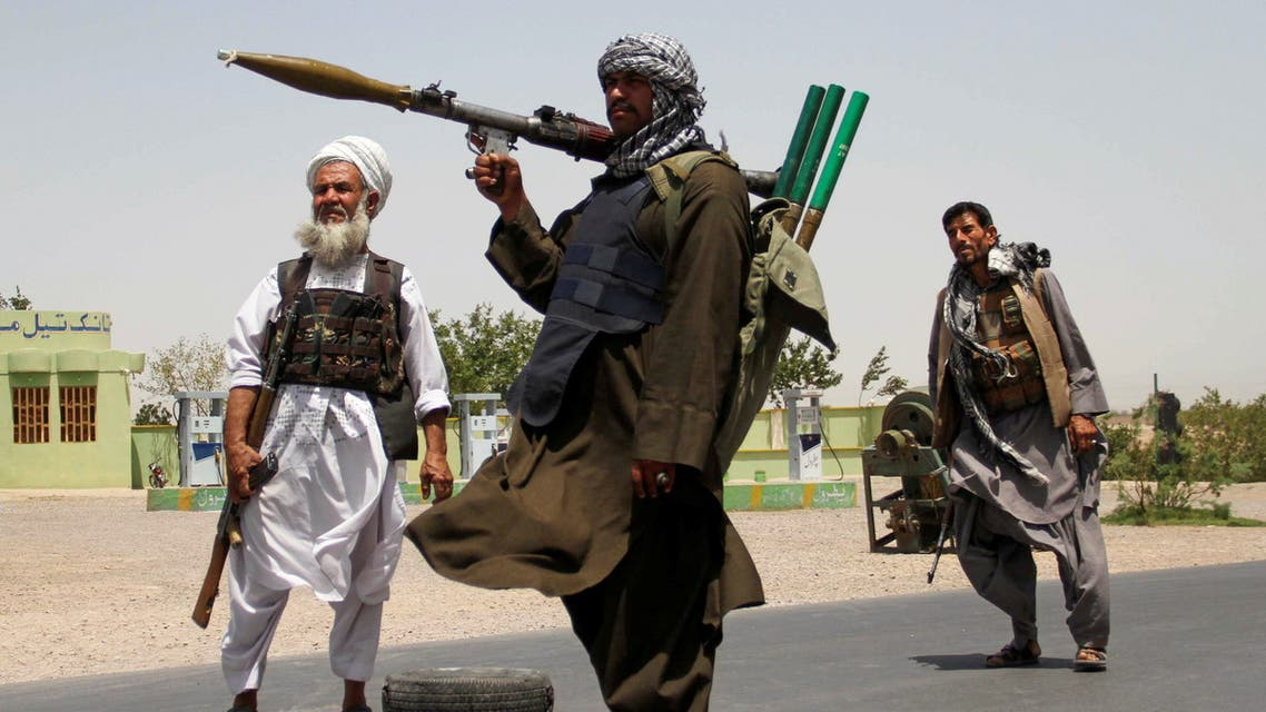 Former Mujahideen hold weapons to support Afghan forces in their fight against Taliban, on the outskirts of Herat province, Afghanistan July 10, 2021. (Reuters)