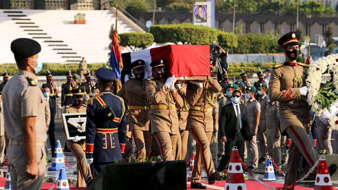 Soldiers carry the flag-draped coffin of Jehan Sadat, widow of former Egyptian President Anwar Sadat, during the official funeral in Cairo, Egypt July 9, 2021. (Reuters)