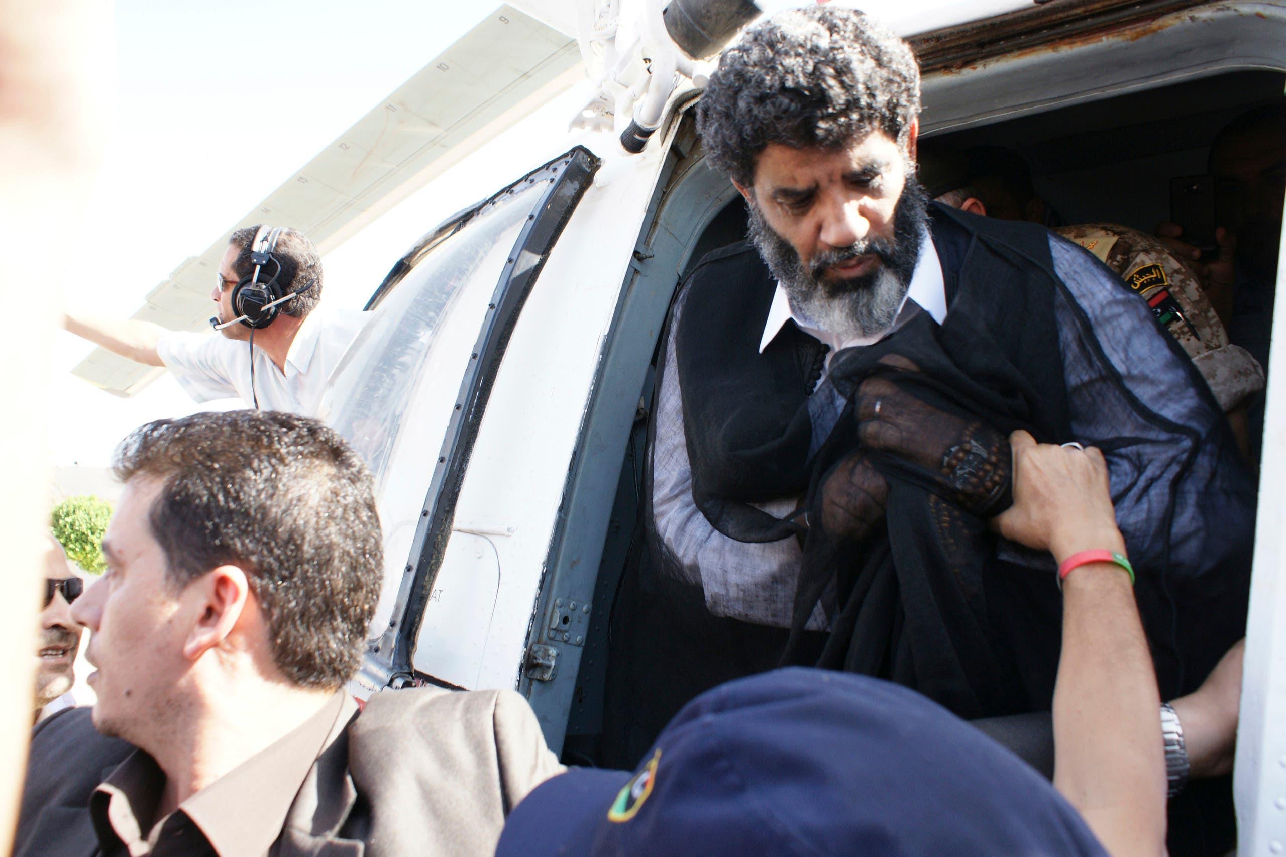 السنوسي عقب اعتقاله في 2012 (رويترز)