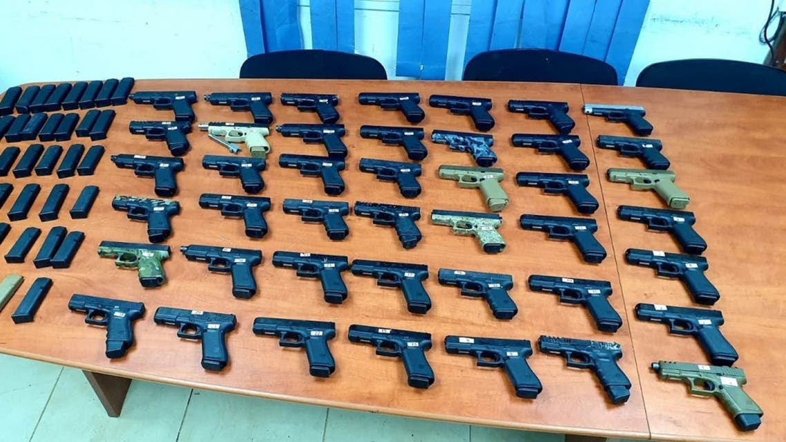 A photo shared by the Israeli army shows the weapons seized in a smuggling attempt on the border with Lebanon. (Twitter)
