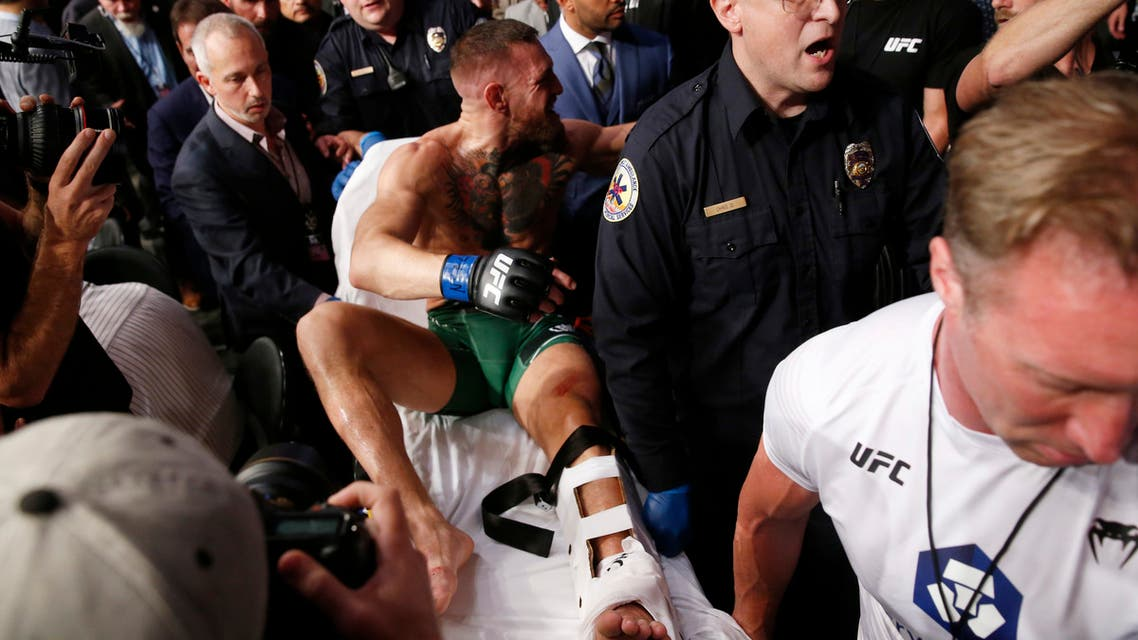 Conor McGregor is stretchered from the octagon after the fight. (Reuters)