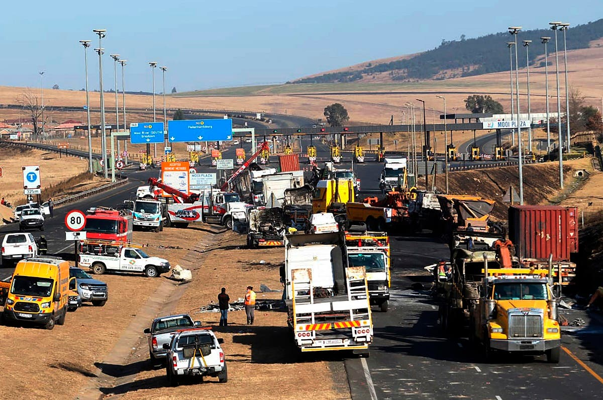 A section of a main freeway, at the Mooi River Plaza in the KwaZulu-Natal Province, South Africa, is blocked off, Saturday, July 10, 2021 after trucks were set alight in overnight protests by supporters of former South African president Jacob Zuma who was imprisoned this week for contempt of court. (AP)