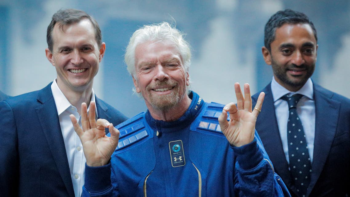 Virgin Galactic co-founder Sir Richard Branson, CEO George Whitesides and Social Capital CEO Chamath Palihapitiya pose together outside of the New York Stock Exchange (NYSE) ahead of Virgin Galactic (SPCE) trading in New York, U.S., October 28, 2019. REUTERS/Brendan McDermid