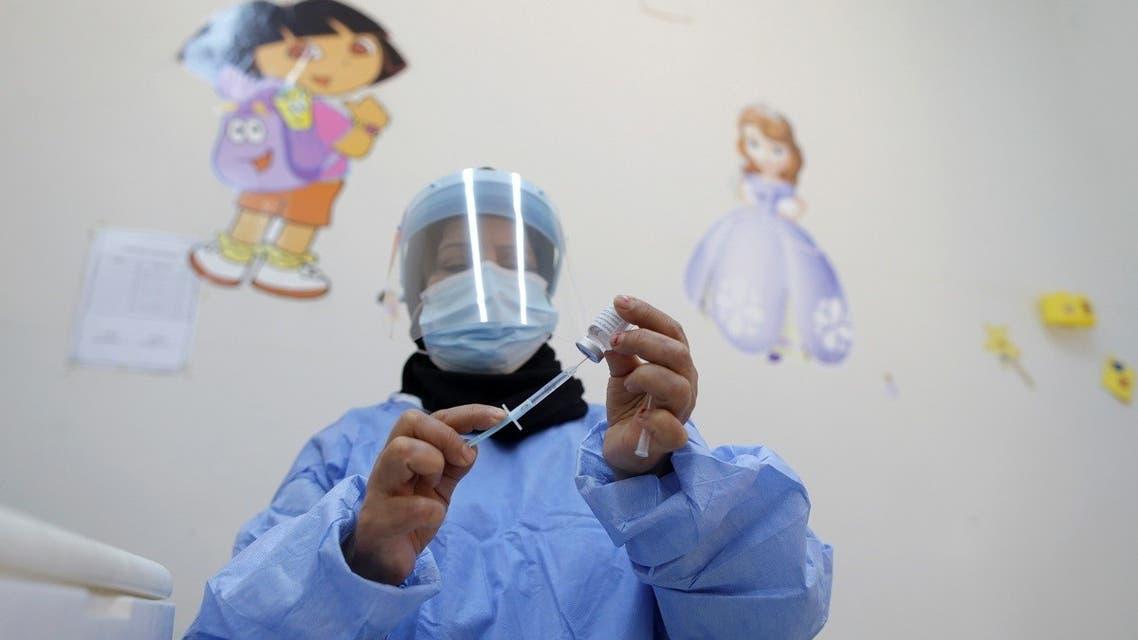 A health worker prepares to administer the AstraZeneca coronavirus disease (COVID-19) vaccine, in Benghazi, Libya April 20, 2021. (Reuters)