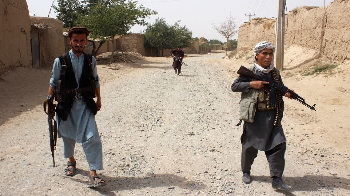 Armed Afghan militias patrol on the outskirts of Takhar province, Afghanistan July 11, 2021. (Reuters)