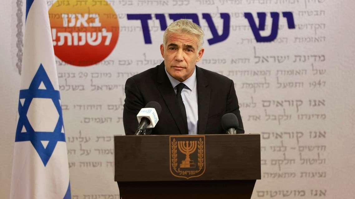 Israeli Foreign Minister Yair Lapid, head of the Yesh Atid party, speaks during a party meeting at the Knesset (Parliament) in Jerusalem on July 5, 2021.