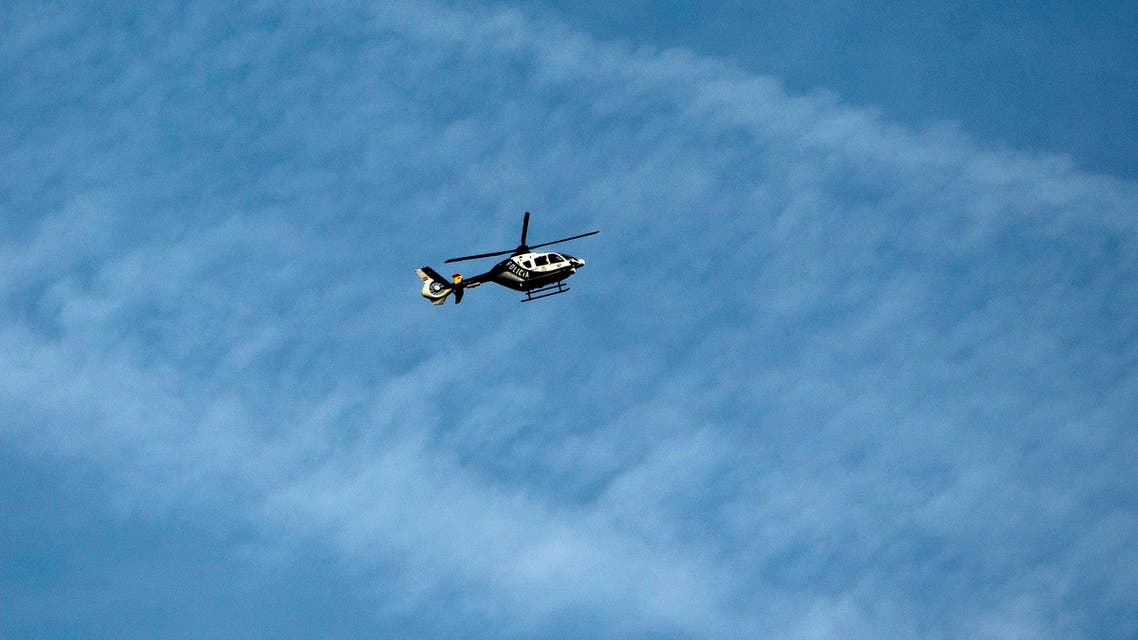 File photo of a police helicopter flying over Madrid, Spain, Thursday, March 26, 2015. (AP)
