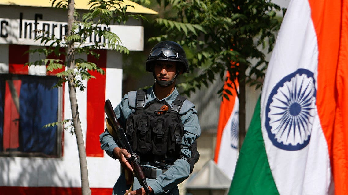 An Afghan policeman stands guard next to India's national flags at a check point in Kabul city. (File photo: Reuters)
