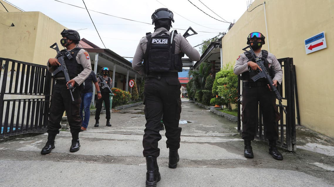 Police officers stand guard at a local police hospital where the bodies of militants killed during a raid were taken to, in Palu, Central Sulawesi, Indonesia, Sunday, July 11, 2021. Indonesian security forces say they have killed two suspected militants with ties to the Islamic State group and who are believed to be connected to the killing of Christian farmers. (AP)