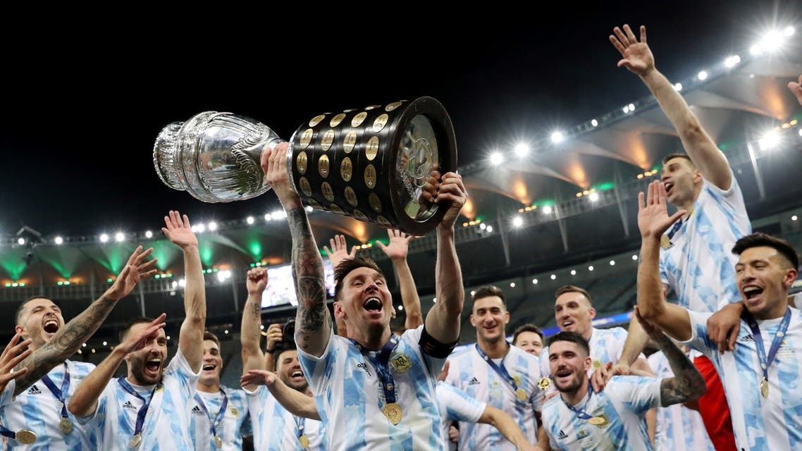 Argentina's Lionel Messi and teammates celebrate winning the Copa America with the trophy. (Reuters)