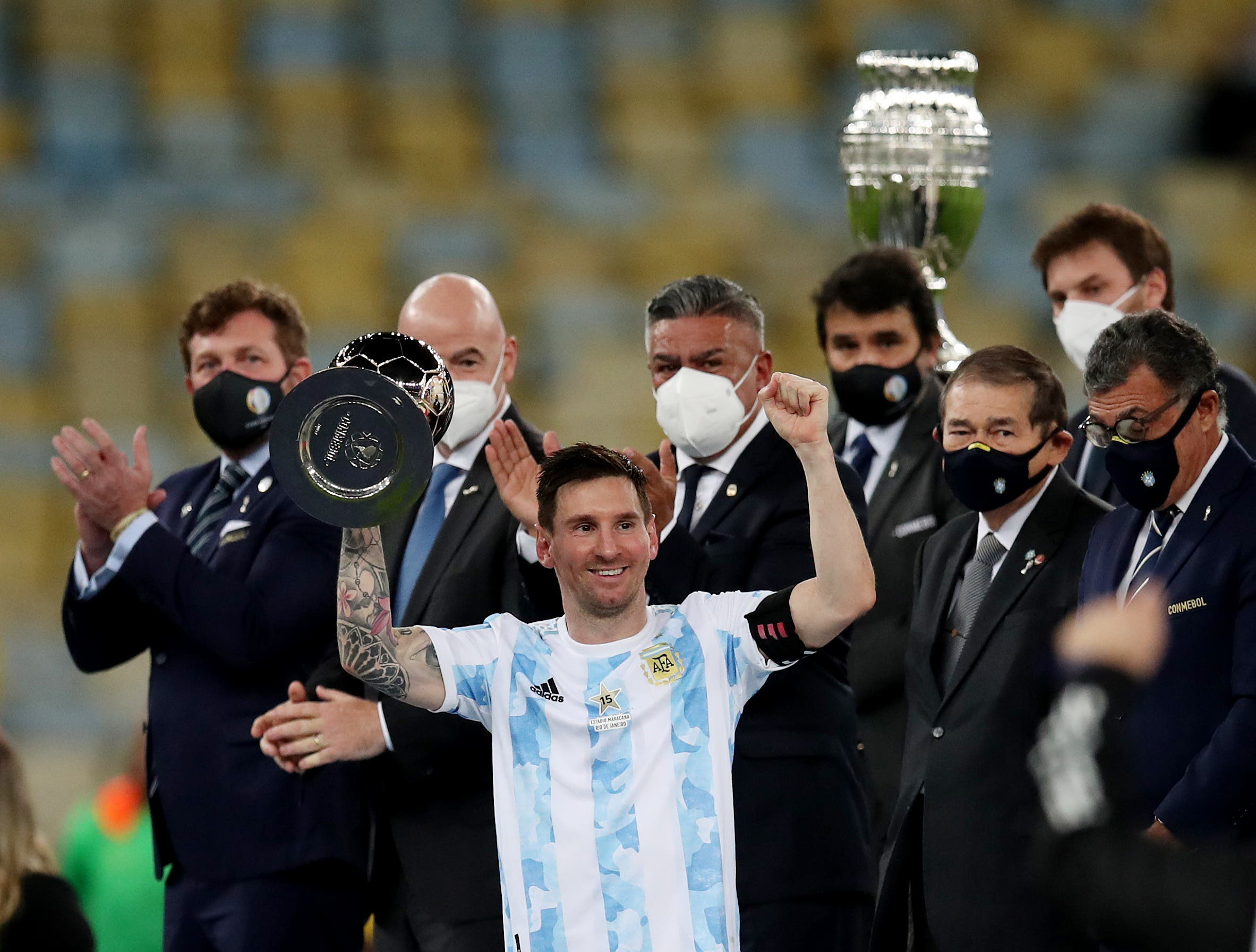 Argentina's Lionel Messi celebrates winning the Copa America with the trophy. (Reuters)