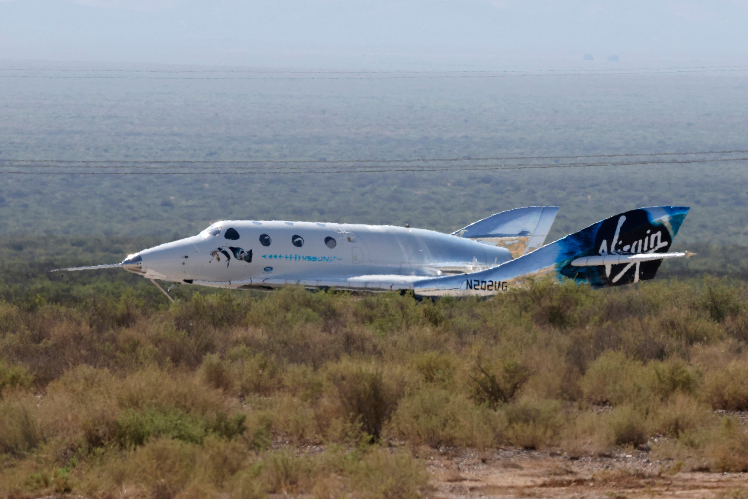 Virgin Galactic's passenger rocket plane VSS Unity, carrying billionaire entrepreneur Richard Branson and his crew, lands after reaching the edge of space above Spaceport America near Truth or Consequences, New Mexico, US, July 11, 2021. (Reuters)