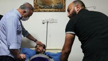 Iraq's PM visits activist Ali al-Mikdam after he was kidnapped, assaulted