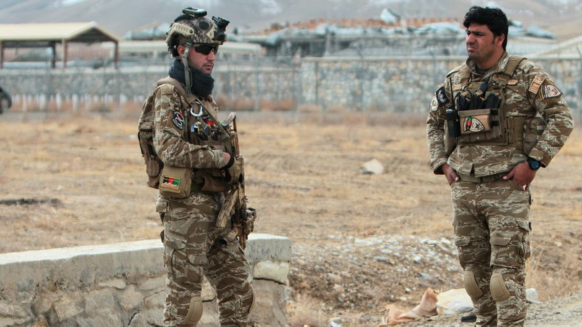 Afghan National Security Forces keep watch outside of a military compound after a car bomb blast on the outskirts of Ghazni city, Afghanistan November 29, 2020. (Reuters)