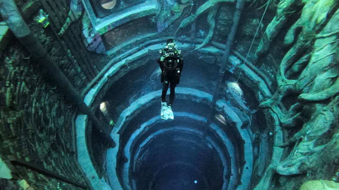 A diver experiences Deep Dive Dubai, the deepest swimming pool in the world reaching 60m, in the United Arab Emirates, on July 10, 2021. (AFP)