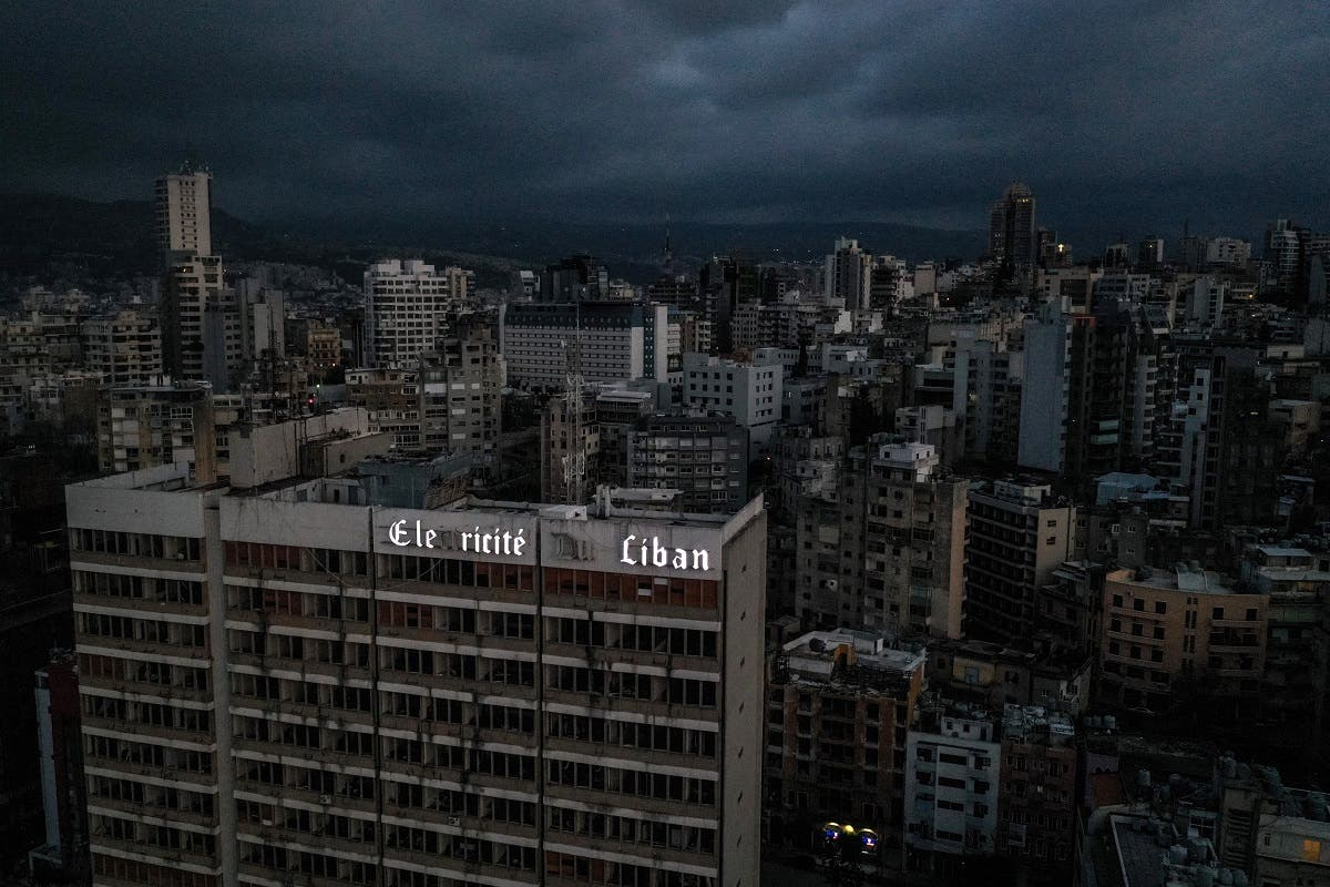 This file photo taken on April 3, 2021, shows an aerial view of Lebanon's capital Beirut in darkness during power outage, with the Electricite du Liban (Electricity Of Lebanon) national company headquarters in the foreground. (AFP)