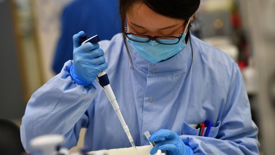 Scientists work at a laboratory where they sequence the novel coronavirus genomes at COVID-19 Genomics UK, on the Wellcome Sanger Institute's 55-acre campus south of Cambridge, Britain March 12, 2021. Picture taken March 12, 2021. REUTERS/Dylan Martinez