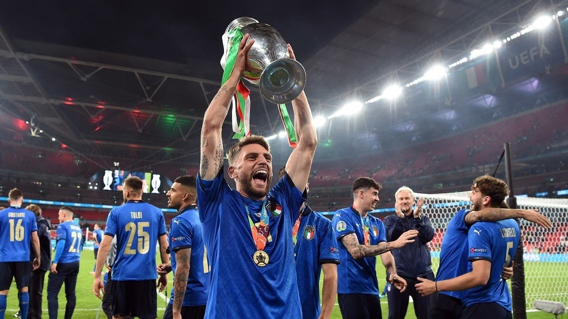 Italy's Domenico Berardi celebrate with the trophy after winning Euro 2020 with teammates. (Reuters)