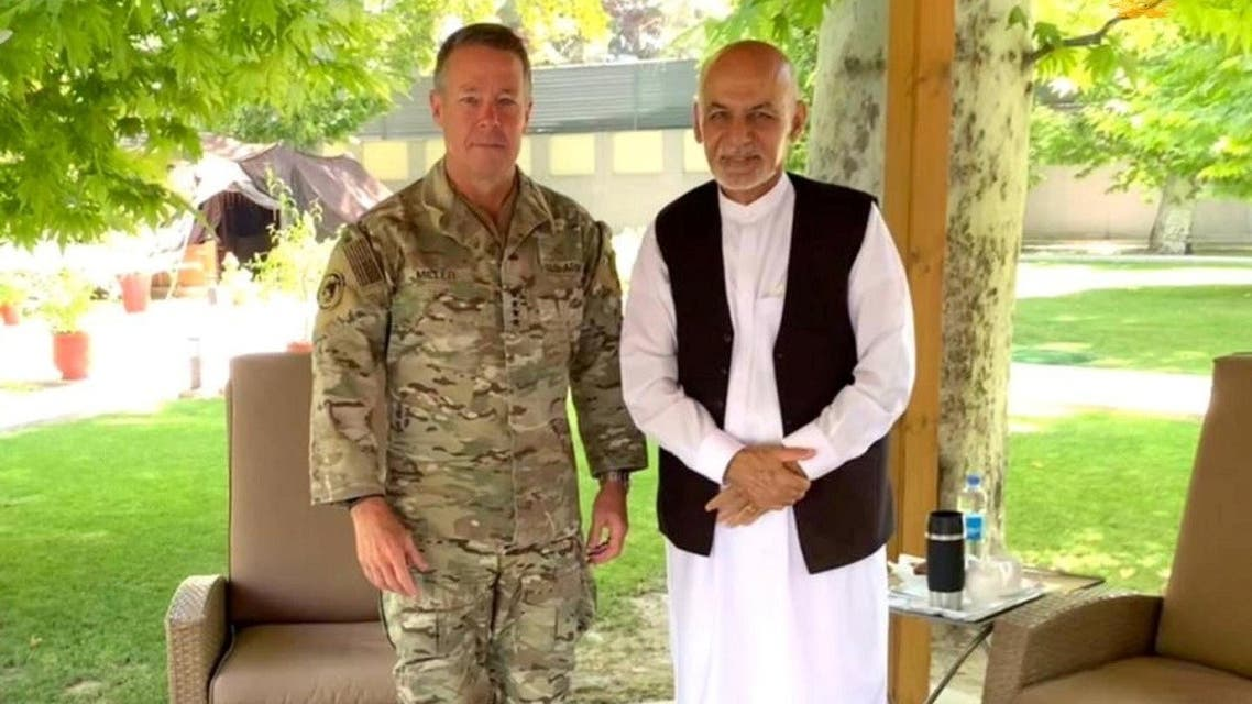 Afghanistan's President Ashraf Ghani (R) meets General Austin Scott Miller, commander of US forces and NATO's Resolute Support Mission in Kabul, Afghanistan, on July 2, 2021. (Reuters)