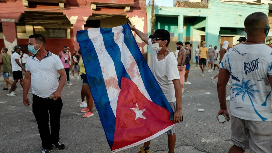 People take part in a demonstration against the government of Cuban President Miguel Diaz-Canel in Havana, on July 11, 2021. Thousands of Cubans took part in rare protests Sunday against the communist government, marching through a town chanting Down with the dictatorship and We want liberty.