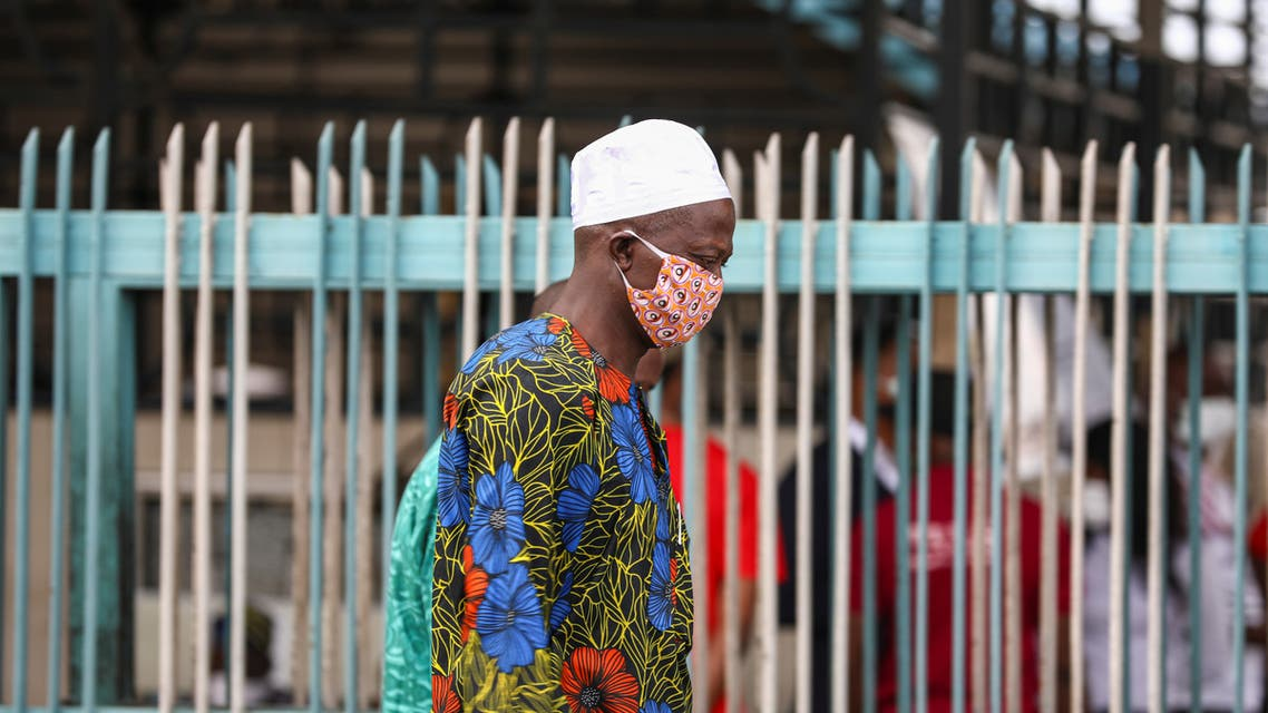 A man wearing a protective face mask is seen on the first day of the easing of lockdown measures during the outbreak of the coronavirus disease (COVID-19) in Lagos, Nigeria May 4, 2020. (Reuters)