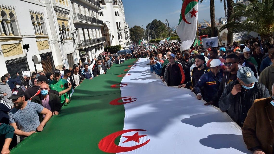 Algerian anti-government protesters take the streets of Algiers on March 26, 2021 as the Hirak pro-democracy movement keeps up its weekly demonstrations despite a ban on gatherings due to the coronavirus pandemic. (AFP)