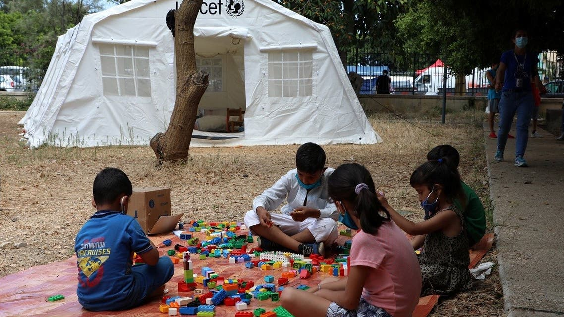 Children play outside a UNICEF tent put in place to provide psychosocial support to people affected by a massive explosion in Beirut's port area, Aug. 20, 2020. (Reuters)