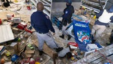 Looting, violence spreads in South Africa as grievances boil over
