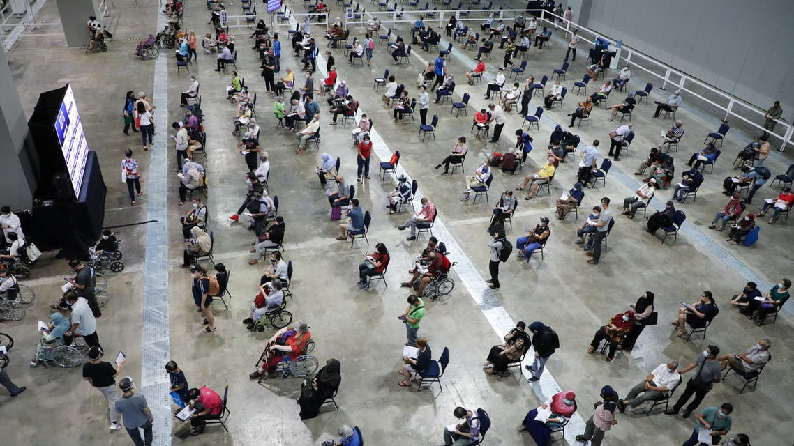 People wait to receive coronavirus disease (COVID-19) vaccines at a vaccination centre in Kuala Lumpur, Malaysia May 31, 2021. REUTERS/Lim Huey Teng