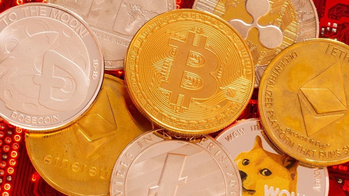 Representations of cryptocurrencies Bitcoin, Ethereum, DogeCoin, Ripple, Litecoin are placed on PC motherboard in this illustration taken, June 29, 2021. (File photo: Reuters)