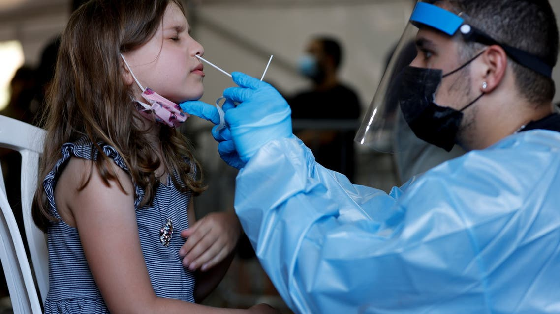 A healthcare worker tests a youth person for the coronavirus disease (COVID-19) at a temporary COVID-19 testing centre, at Rabin Square in Tel Aviv, Israel July 8, 2021. (Reuters)