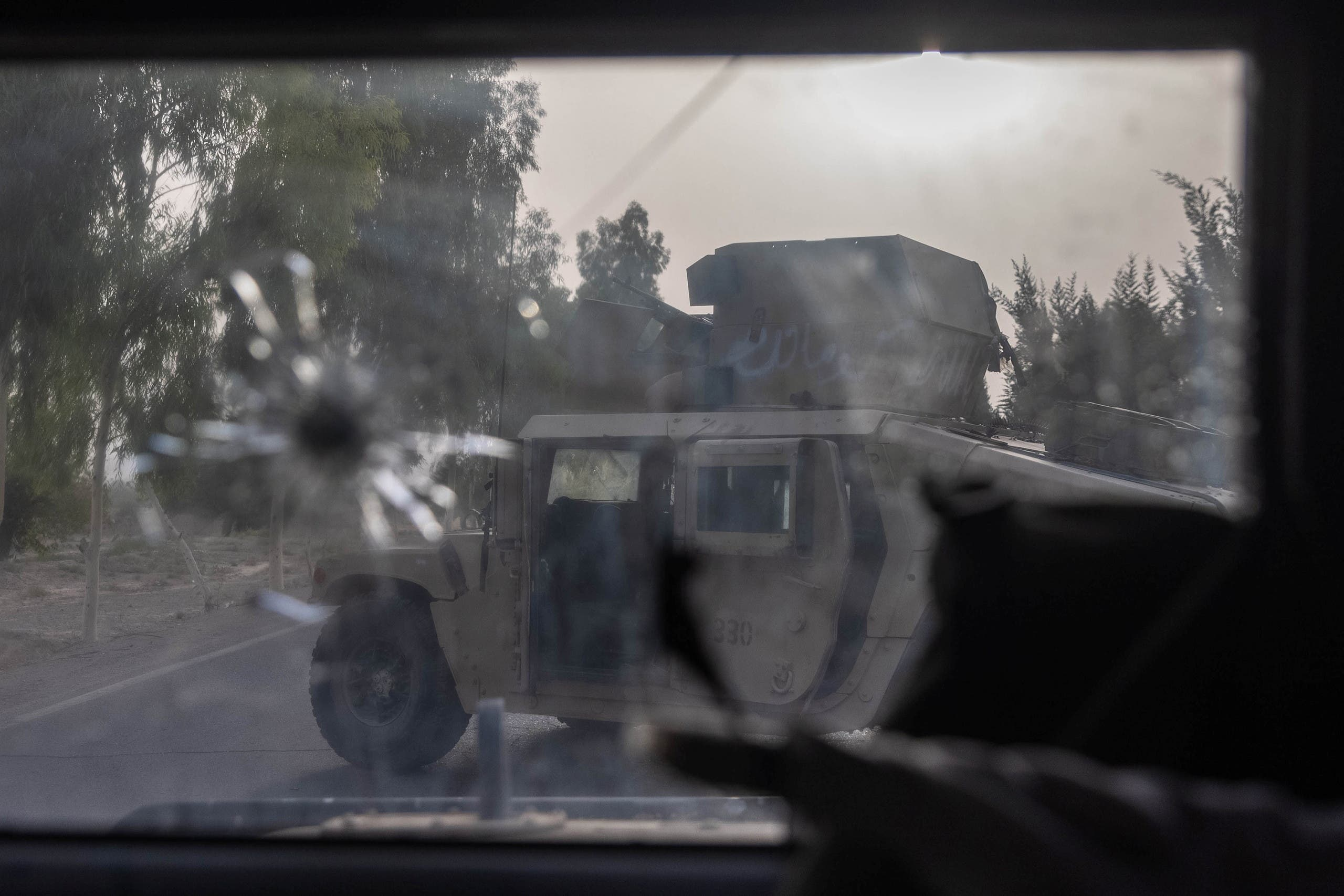 A humvee belonging Afghan Special Forces is seen destroyed during heavy clashes with Taliban during the rescue mission of a police officer besieged at a check post, in Kandahar province, Afghanistan, July 13, 2021. (Reuters)