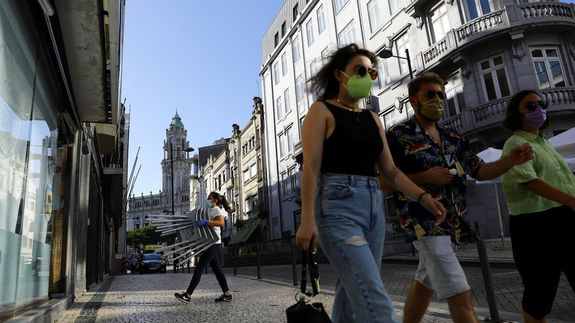 A restaurant staff carries chairs, on the day that Portugal's government imposed stricter rules in an attempt to bring under control a surge of coronavirus disease (COVID-19) cases, in Porto, Portugal, July 10, 2021. (Reuters)