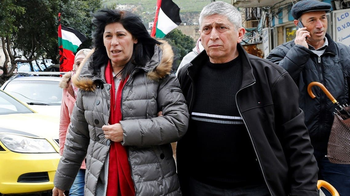 File photo of Khalida Jarrar, a senior Popular Front for the Liberation of Palestine's (PFLP) political figure, walks with people after she was released from an Israeli jail, in Nablus, in the Israeli-occupied West Bank, on February 28, 2019. (Reuters)