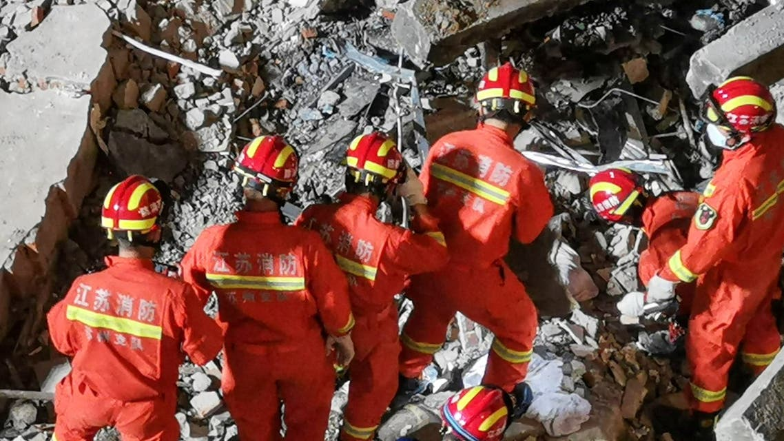This photo taken on July 12, 2021 shows rescuers searching at the site of a hotel after it collapsed leaving at least one dead and 10 others missing in the city of Suzhou in China's eastern Jiangsu province. (File photo: AFP)