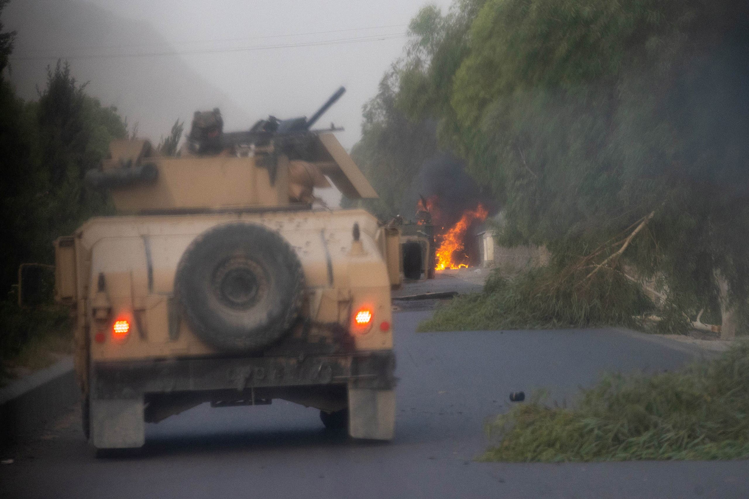 Humvees that belong to Afghan Special Forces are seen destroyed during heavy clashes with Taliban during the rescue mission of a police officer besieged at a check post, in Kandahar province, Afghanistan, July 13, 2021. (Reuters)