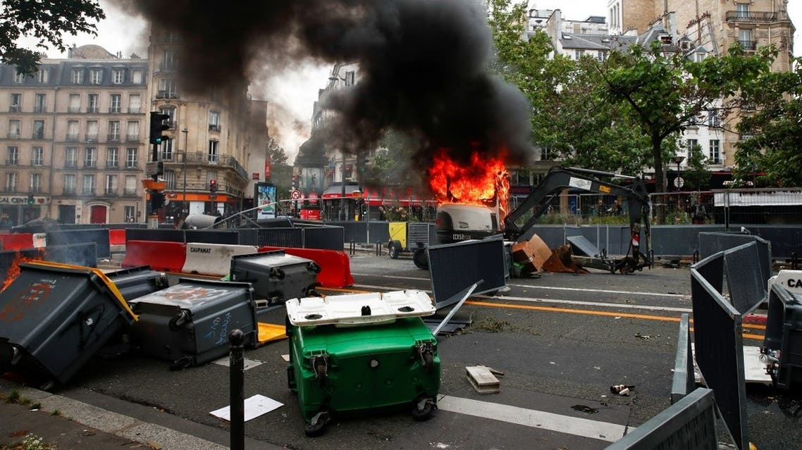 A view shows a burning backhoe loader during a demonstration against the new measures announced by French President Emmanuel Macron to fight the coronavirus outbreak, in Paris, France, on July 14, 2021. (Reuters)